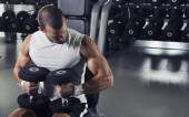 Handsome Muscular Male Model Posing With Dumbbells  — Zdjęcie stockowe