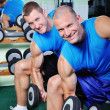 Muscular man exercising in a gym — Stock Photo #57076011