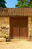 Old stone medieval wall with gate made of wood — Stock Photo