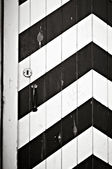 Wooden doors painted in black & white stripes — Stock Photo