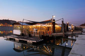 Restaurant on a river in Lyon. Evening in the french city. — Stock Photo