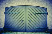 Garage door in retro vintage colors. Double sided doors of modern garage in a building. — Stock Photo