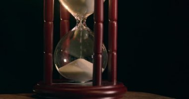 Beautiful wooden hourglass measures the time by sand — Stock Video