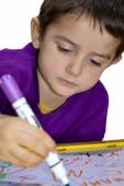 Young boy write — Stock Photo