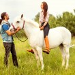 Young beautiful couple with a horse at sunset. — Stock Photo #52410025