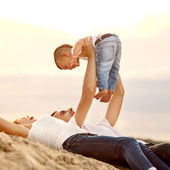 Family love laughing and playing on the beach — Foto de Stock