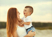 Happy mother and son in the mountains playing — Stock Photo