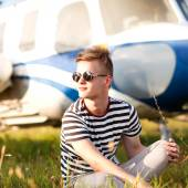 Fashion man near helicopters at the airport — Stock Photo