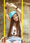 Fashion girl ride on a swing. hipster style — Stock Photo