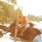 Man on the beach at sunset — Stock Photo #60550989