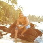 Man on the beach at sunset — Stock Photo #60551677