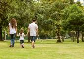 Family walk in the park, happy at sunset in Bangkok, Thailand. — Stock Photo