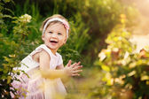 Beautiful Toddler In Garden Smiling and Clapping  — Stock Photo