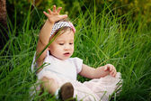 Little Girl Playing in the Grass — Stock Photo