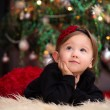 Baby Girl Under Christmas Tree — Stock Photo #63055901