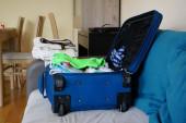 Blue suitcase — Stock Photo