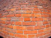 Red brick wall with distortion lens — Stock Photo