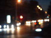 Blurred out of focus lights from cars in a night scene — Stock Photo