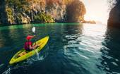 Woman with the kayak — Stock Photo