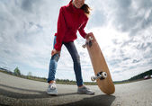 Young lady with skateboard — Stock Photo