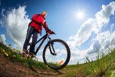 Hiker with bike — Stock Photo