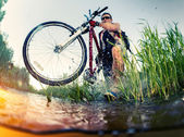 Young man crossing the swamp — Stock Photo