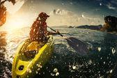 Young lady paddling the kayak — Stock Photo