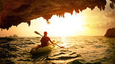 Young lady paddling the kayak — Foto de Stock