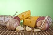 Salame, garlic and cheese — Stock Photo