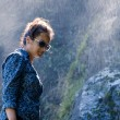 Young Nepalese woman next to waterfall — Stock Photo #61404403