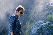 Young Nepalese woman next to waterfall — Stock Photo