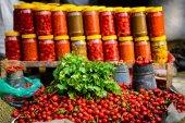 Coriander, chillis and jars on a market — Stock Photo