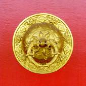 Golden door knocker at Kapan buddhist monastery — Stock Photo