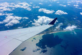 Wing of an airplane in flight — Stock Photo