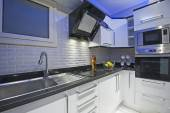Kitchen area in luxury apartment — ストック写真