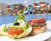Closeup of beef burger with salad — Stock Photo