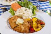 Chicken schnitzel meal — Stock Photo