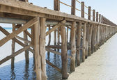 Wooden jetty in a tropical lagoon — Stock Photo