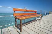 Wooden bench on tropical jetty — Stock Photo