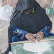 Bedouin woman making traditional bread — Stock Photo #61475591
