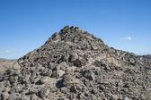 Rocky desert mountain with blue sky background — Stock Photo