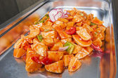 Sweet chilli potatoes at a chinese buffet — Stock Photo