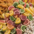 Closeup of sugary fruit sweets at a market — Stock Photo #69601463