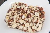 Bowl of almond nuts snack food — Stock Photo