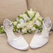 Brides wedding shoes with a bouquet — Stock Photo #71389925