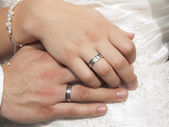 Bride and groom hands showing rings — Stock Photo