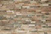 Fake stone wall brick background wallpaper — Stock Photo