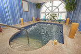 Large jacuzzi in a health spa — Stock Photo
