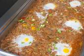 Minced beef with fried egg at an oriental restaurant buffet — Stock Photo