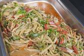Calamari with vegetables at an oriental restaurant buffet — Stock Photo